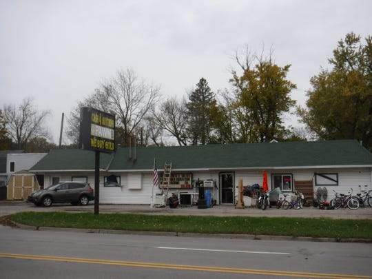 A former party store on West Grand River Avenue in Williamston is among the properties headed for auction in Ingham County on July 30.