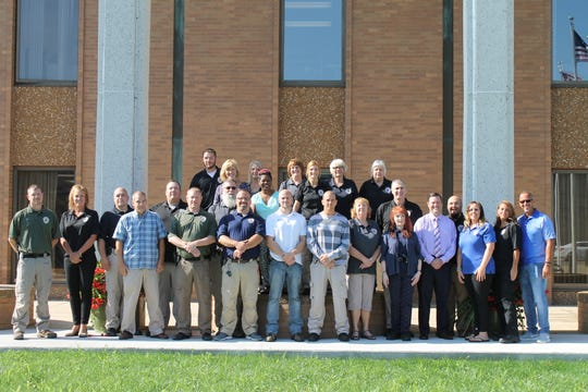Local probation officers and staff pose for a group picture.