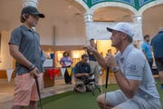 July 23, 2019 - St. Jude patient Dakota, 13, (left) gets advice from professional golfer Bryson DeChambeau as PGA golfers visit St. Jude patients for a round of putt-putt golf inside the ALSAC pavillion on the campus of St. Jude Children's Research Hospital.
