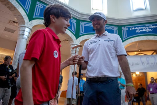 July 23, 2019 - St. Jude patient Bailey, 14, gets a fist bump from Max Homa as PGA golfers visit St. Jude patients for a round of putt-putt golf inside the ALSAC pavillion on the campus of St. Jude Children's Research Hospital.
