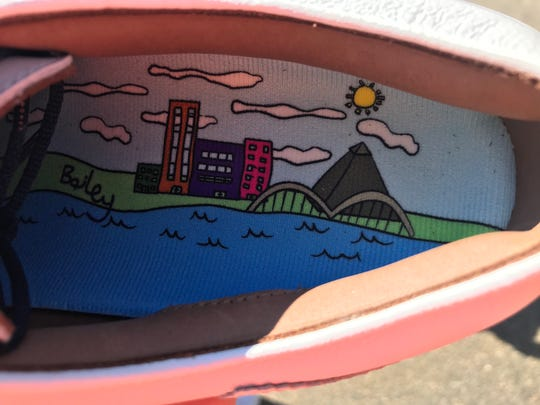 Memphis resident and 14-year-old former St. Jude patient Bailey Jessop designed a pair of golf shoes for Justin Thomas featuring the Memphis skyline.