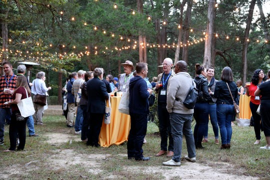 Attendees at the 2018 Southern Foodways Alliance symposium enjoy a cocktail reception at Rowan Oak in Oxford, Miss.