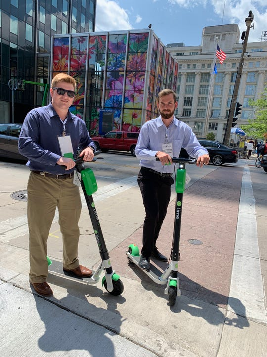 Kyle Lovelace, left, and Garrett McWilliams enjoy the newly rolled out Lime scooters.