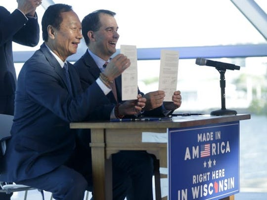 Foxconn Chairman Terry Gou and Gov. Scott Walker display the memorandum of understanding they signed during a July 27, 2017, ceremony at the Milwaukee Art Museum.