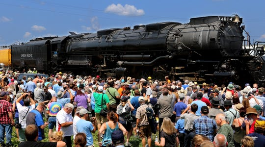People crowd around the newly restored Big Boy No. 4014, the world's largest steam locomotive, Tuesday in Altoona.