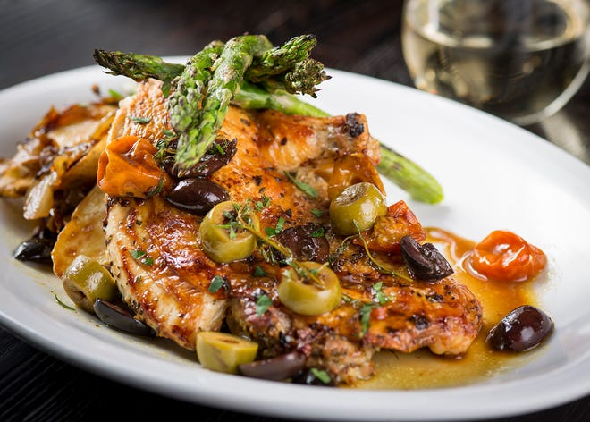 Brick chicken, a boneless half chicken in white wine sauce with roasted cherry tomatoes and asparagus, is one of the dishes customers can expect at the Pivot Room, the first dedicated restaurant by the WhirlyBall chain. It's due to open at Brookfield Square in the fall.