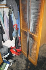 This closet door in a West Allis apartment caught fire after a bag of hot laundry was left a lone to smolder and ignite, according to the West Allis Fire Department.