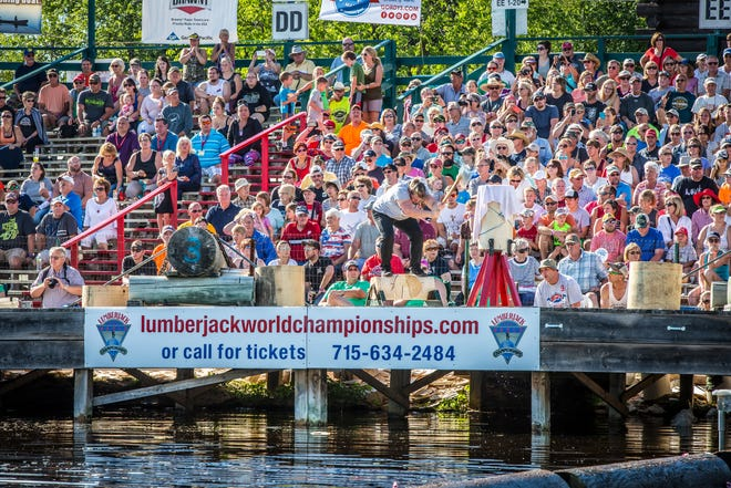A crowd watches a competition at the Lumberjack World Championships in Hayward.