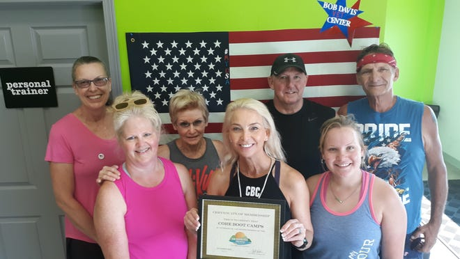 Core Boot Camps, located at 1350 East Side Centre Court in Mountain Home, was recently inducted into the Mountain Home Area Chamber of Commerce.Owner Angela Collins (holding certificate) says she offers custom-tailored programs designed to squeeze maximum benefit from minimal time, because lack of time is the biggest reason so many otherwise successful individuals have lost their feeling of wellness in a sea of deadlines, pressure and stress.For more information visit their website or call (870) 321-4176. Membership inductions occur when a business has been in the community for some time and joins the Chamber.
