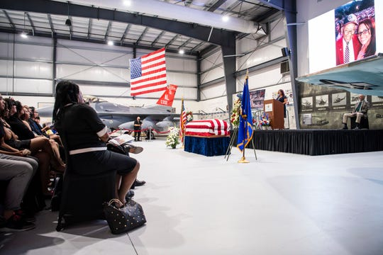 Lt. Col. Robert Friend's memorial service July 7, 2019, at the Palm Springs Air Museum, CA. One of the present 100th Fighter Squadron F-16 Red Tails, left, was on display for the ceremony.