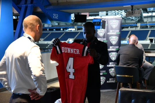 Ball State's Malik Dunner checks out a jersey during Mid-American Conference Football Media Day. Dunner is a senior receiver for the Cardinals.