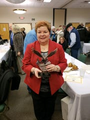 Vicki Taylor shows off award for her 35 years of service as secretary for Rutherford County mayors. She died of a heart attack Monday.