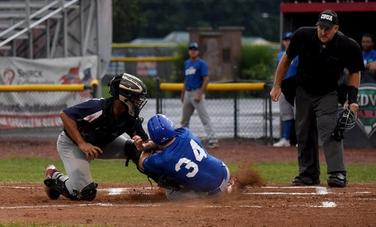 Settlers' catcher Darius Diaz tags out Cincinnati Steam runner Drew Reckart at the plate to get out of the first inning. The Settlers lost to the Steam 6-3 on Monday, July 22, 2019.
