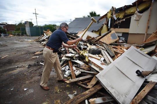 Superintendent Pablo Munoz Munoz hammers the remaining debris as the final demolition takes place at School #1, Thomas Jefferson School in Passaic on 07/23/19.