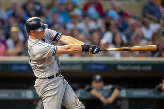 Jul 22, 2019; Minneapolis, MN, USA; New York Yankees second baseman DJ LeMahieu (26) hits a two run home run in the fifth inning against the Minnesota Twins at Target Field. Mandatory Credit: Jesse Johnson-USA TODAY Sports