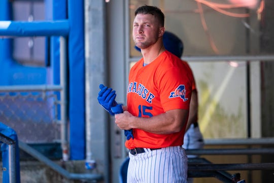 Syracuse Mets left fielder Tim Tebow earlier this month