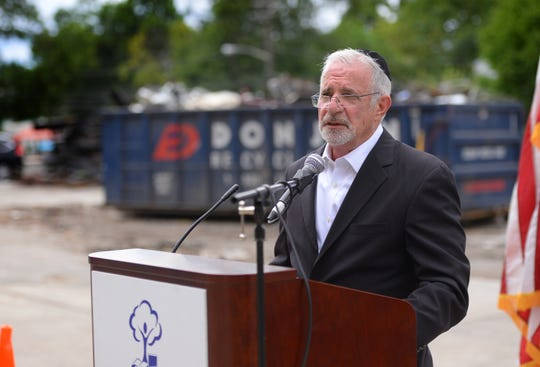 Assemblyman and Passaic City Council President Gary Schaer  gives a brief speech to staff and contractors as the final demolition takes place at School #1, Thomas Jefferson School in Passaic on 07/23/19.