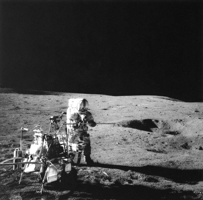 In this Feb. 6, 1971, file photo, Apollo 14 Astronaut Alan B. Shepard Jr., who hit three golf balls while on the moon, conducts an experiment near a lunar crater, using an instrument from the two-wheeled rickshaw cart carrying the various test tools. Five trees planted in New Mexico from seeds taken to the moon during the Apollo 14 and given to the state by NASA have all died or been forgotten, according to officials at the locations where the trees were planted decades ago.