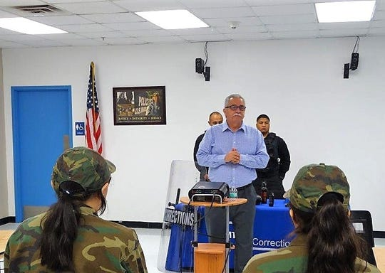 Otero County Prison Facility Warden Rick Martinez talks to Santa Teresa High School students July 19.