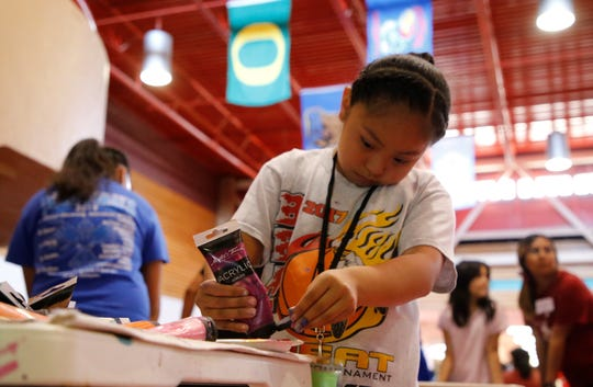 Youth between ages 7-18 participate in various activities, such as painting, at iMPACT Shiprock on July 23 at Shiprock High School in Shiprock.
