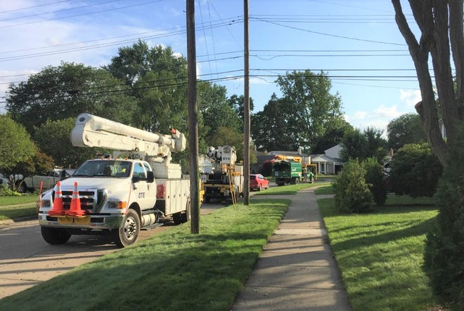 DTE and privately-owned tree-trimming company trucks lined Ivywood Street Monday evening.