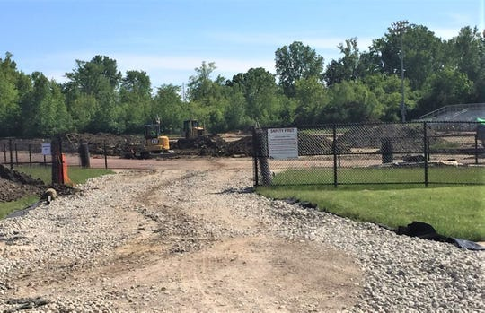 The renovation of the Plymouth-Canton Community Schools' junior-varsity football field has hit a few expensive ruts.