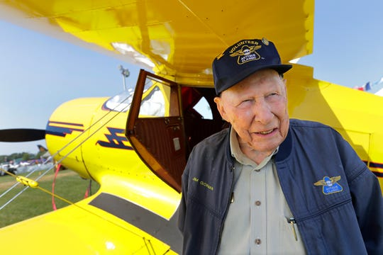 Jim Gorman, 95, of Mansfield, Ohio, talks about his history with EAA under the wings of his 1946 Beech Staggerwing G17S airplane Tuesday during EAA AirVenture at Wittman Regional Airport in Oshkosh.
