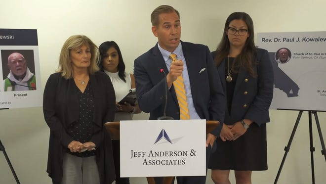 Patricia Harner, left, plaintiff in a lawsuit against the Episcopal Diocese of Los Angeles, takes part in a news conference on Tuesday, July 23, 2019, at her lawyer's office. Others in the photo are among the legal team representing her.
