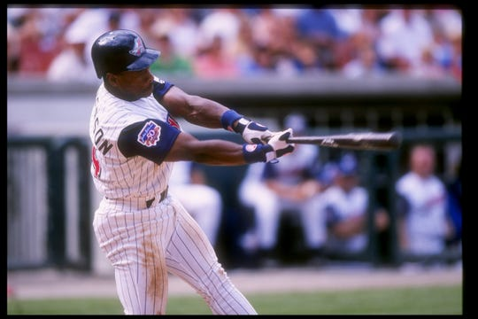 Rickey Henderson of the Anaheim Angels swings at the ball during a game against the Kansas City Royals in 1997. Henderson is one of five Hall of Famers to play for both the Dodgers and the Angels.