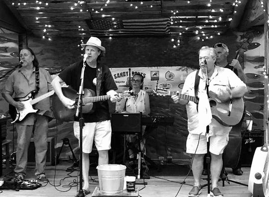 The BeachBilly's performing at the The Point Restaurant in Pensacola.  From left to right: James Daniels, T-Bone Montgomery, Augie Savage, Mark Sherrill, and Dave Caluger.