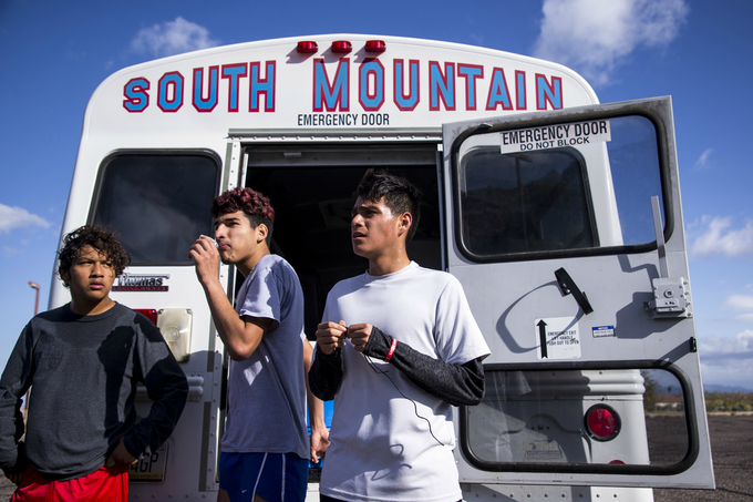 From left to right: South Mountain High School students Erik Gomez, Alberto Gonzalez, and Carlos Hernandez rest after cross country practice on March 13, 2019, in Phoenix.