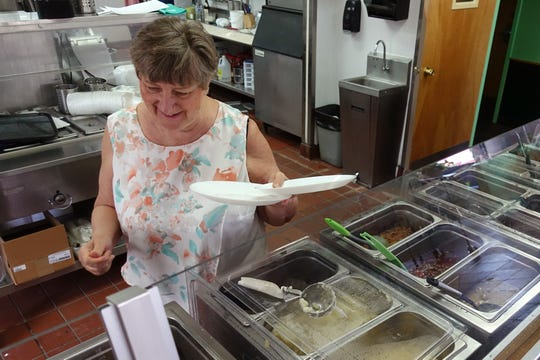 Hanna Gabrielsson serves customers Polish and Swedish fare from a cafeteria-style line at her new restaurant, BeCe Kitchen in Sun Lakes.