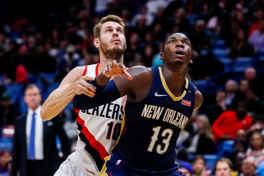 Pelicans forward Cheick Diallo boxes out Trail Blazers forward Jake Layman during a game at Smoothie King Center.