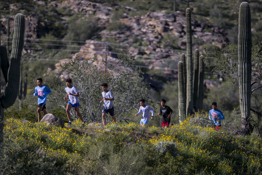 South Mountain High School cross country athletes run during practice on March 13, 2019, in Phoenix.