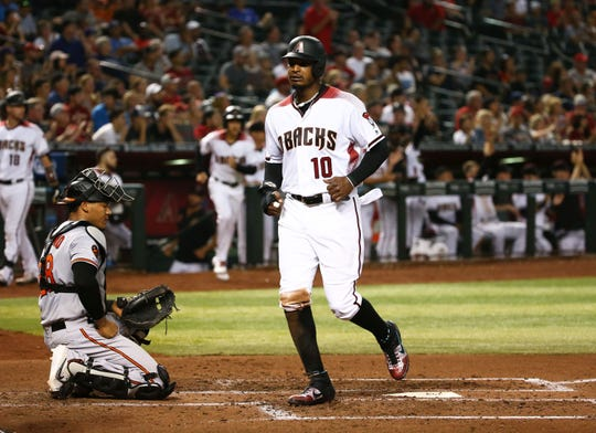 Arizona Diamondbacks Adam Jones scores on a Jake Lamb double against the Baltimore Orioles in the third inning at Chase Field on July 22, 2019 in Phoenix, Ariz.