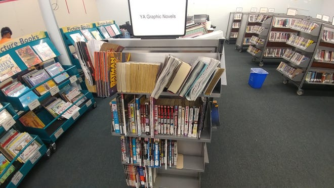 Some of Mesa Express Library's collection was damaged after Monday's storms.