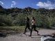 South Mountain High School students Gissele Campos (left) and Andrea Calderon run during cross country practice on March 13, 2019, at South Mountain in Phoenix.