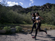 South Mountain High School students Gissele Campos (left) and Andrea Calderon run during cross country practice on March 13, 2019, in Phoenix.