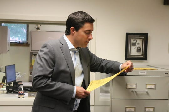 Ohio Secretary of State Frank LaRose checks a sample ballot for the special election in August 2019 during a tour of the Ottawa County Board of Elections facilities.