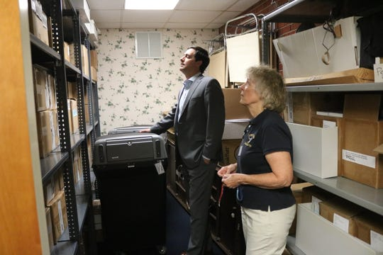 Ohio Secretary of State Frank LaRose tours the Ottawa County Board of Elections with director Carol Ann Hill.