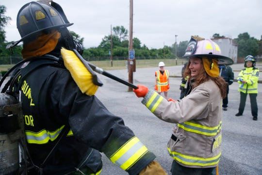 Pleasant Valley Fire Department firefighter EMT Melissa Lawlor decontaminates the Dutchess County fire instructor Tom Murphy's turnout gear during training on July 11, 2019.