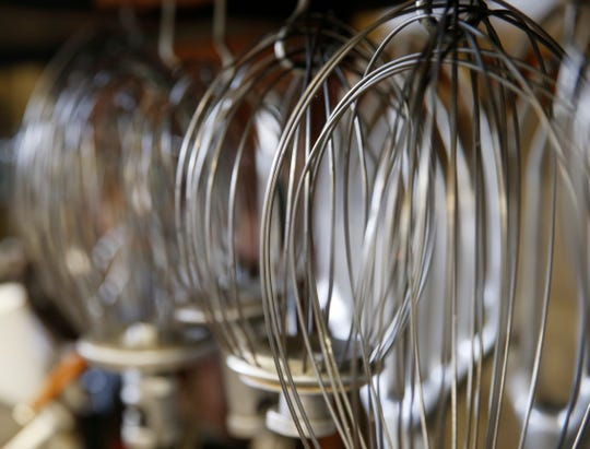 Rows of mixer whisks inside the bakery at Caffe Aurora in the City of Poughkeepsie on July 23, 2019.
