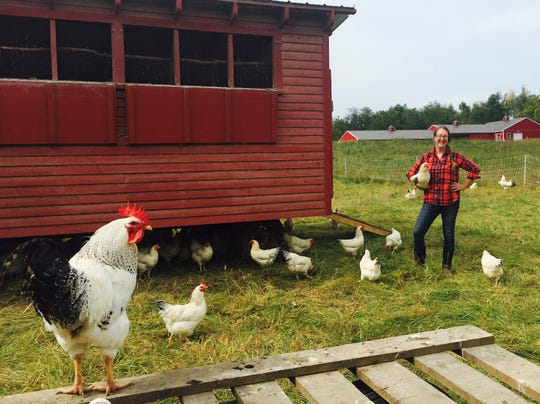 Katie Bogdanffy is shown on Yellow Bell Farm in Red Hook with some of her chickens.