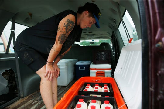 Sarah Chase loads a cooler in preparation for heading to New York City for a farmers market at Chaseholm Farm in Pine Plains on July 12, 2019.