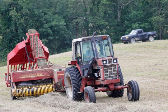 Tom Hahn uses his accumulator which creates hay bales during hay harvesting at Hahn Farm in Salt Point on July 11, 2019.