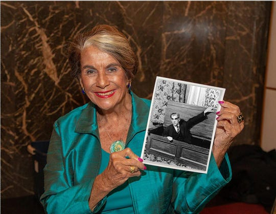 "Sara Karloff, daughter of Boris Karloff, holds a photograph of her father from the production of ""Arsenic and Old Lace."" She will be at the Friday-Saturday shows of the production presented by Theatre on the Road on Bannerman Island."
