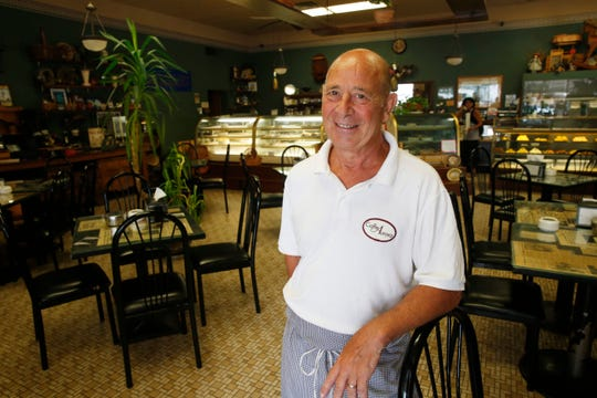 Caffe Aurora owner Lou Strippoli in the cafe on July 23, 2019. Strippoli is planning to sell or lease the nearly 80-year-old business within a year.
