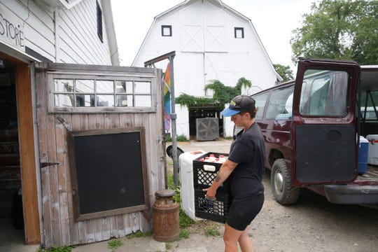 Sarah Chase prepares for a New York City farmers market at Chaseholm Farm in Pine Plains on July 12, 2019.