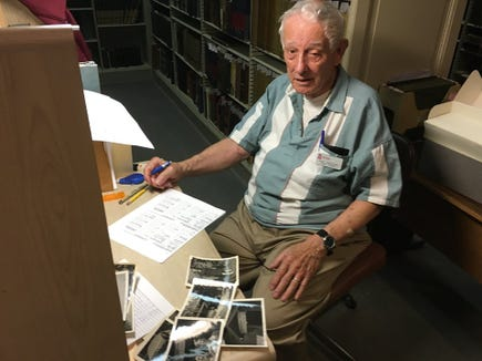 Veteran archivist Paul Wolfgang patiently catalogues photos in the rear of the York County History Center's archives.