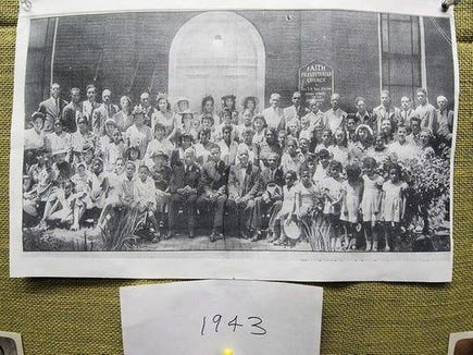 "Calvin Palmer found himself in this photograph of Faith Presbyterian's North Duke Street congregation in 1944. (He says the photo is misdated.) ""I am in the photo sitting on my grandmother's lap, left front row. Her name is Muriel Hamilton … . I appear to be about six months old in the photo. My mother Helen Hamilton Palmer is at the left end of the 2nd row. It appears that I'm the youngest person in the photo."""